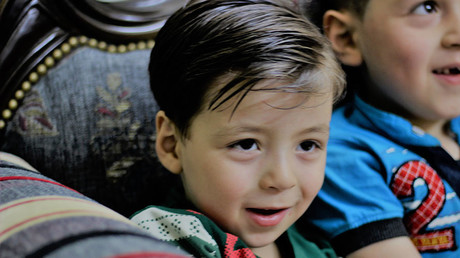Omran Daqneesh, still living in liberated Aleppo, under the control of the Syrian government. A happy, well-adjusted little boy. ©Vanessa Beeley