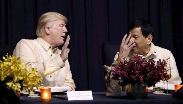 U.S. President Trump talks with Philippines President Rodrigo Duterte during the gala dinner marking ASEAN's 50th anniversary in Manila, Philippines.