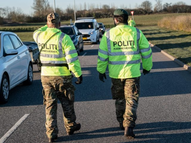 Police watch people queueing up in their cars at the recycling site for public waste on March 31, 2020 in Fredericia, Denmark, after recycling sites all over Denmark reopened following its closure by the government amid the Coronavirus Covid-19 lockdown for almost three weeks. (Photo by Claus Fisker / Ritzau …
