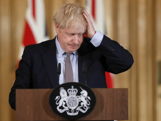 Britain's Prime Minister Boris Johnson reacts during a press conference at 10 Downing Street in London on March 3, 2020 to unveil government planning to combat coronavirus. - The government published their plans for measures to tackle the spread of coronavirus in the UK. (Photo by Frank Augstein / POOL …