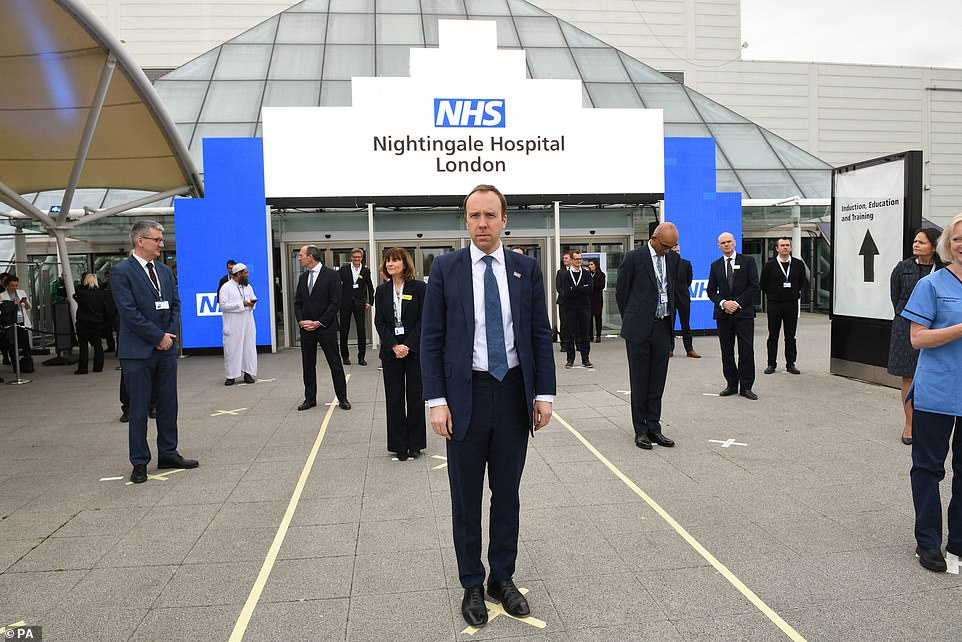 Health Secretary Matt Hancock and NHS staff stand on marks on the ground to help with social distancing at the opening of the NHS Nightingale Hospital at the ExCel centre in London today