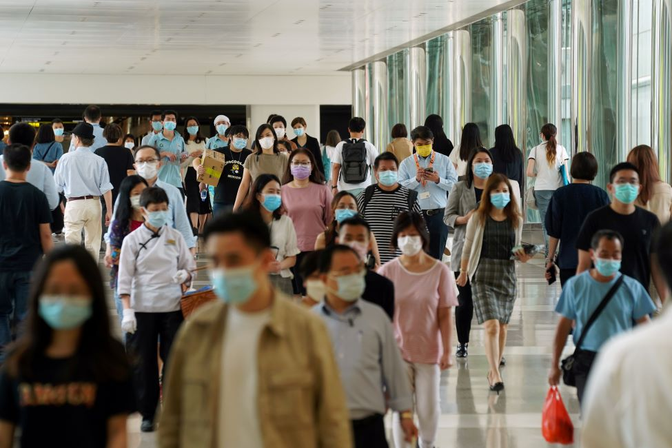 People wearing face masks following the coronavirus disease (COVID-19) outbreak walk at a shopping mall in Hong Kong, China July 20, 2020. REUTERS/Lam Yik