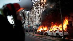 Paris protesters torch cars, set BANK on fire amid clashes over bill slammed as 'ban on filming police brutality' (VIDEOS)