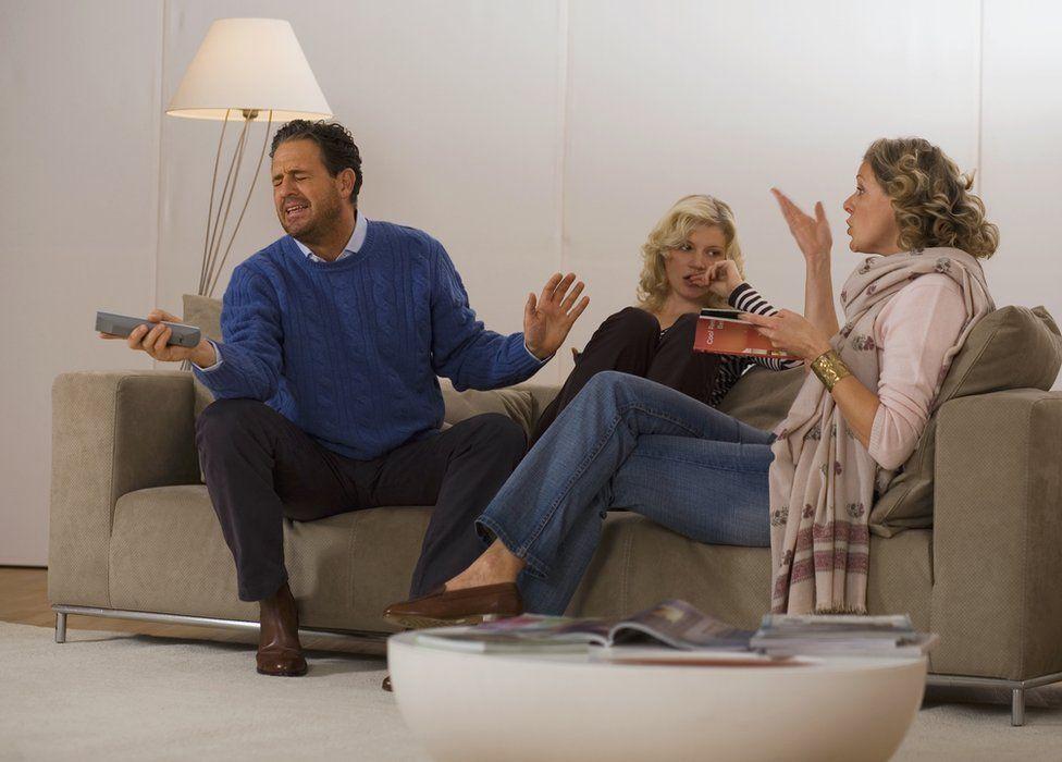 Family on a sofa arguing