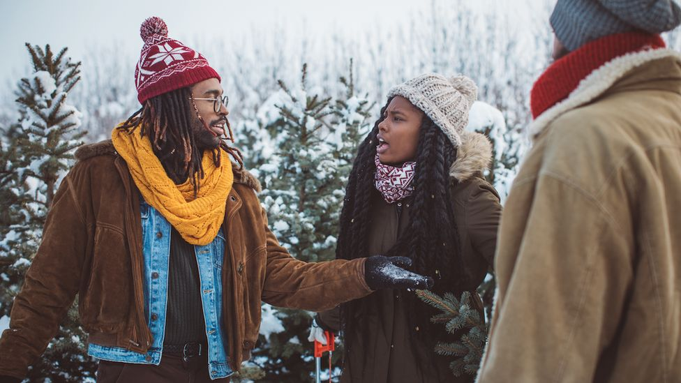 A man and a woman argue in the snow