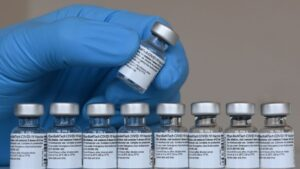 Federal law prohibits employers and others from requiring vaccination with a Covid-19 vaccine distributed under an EUA